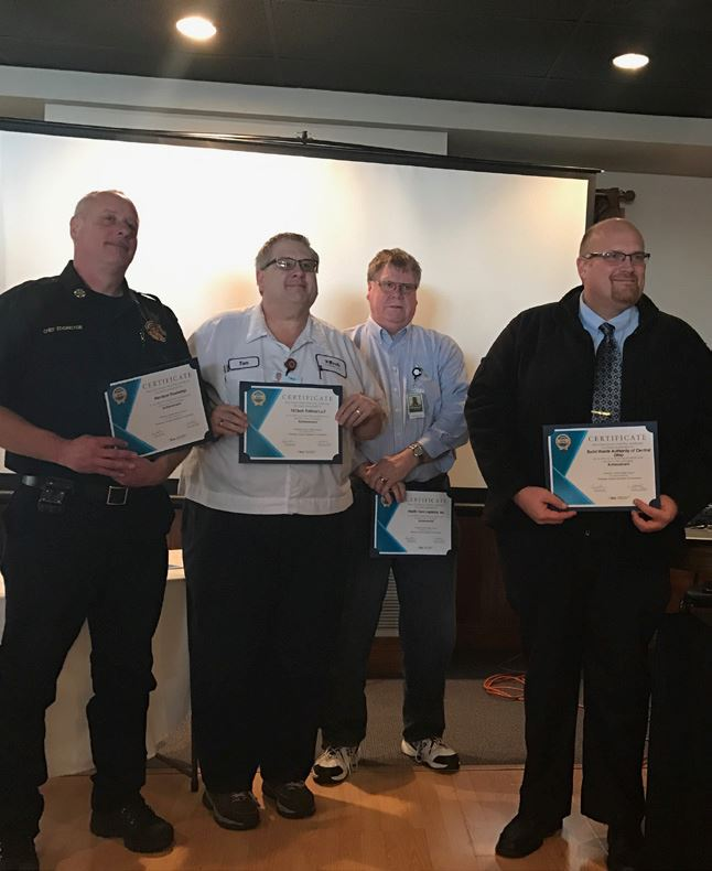 Director of Ops and others accept BWC safety award